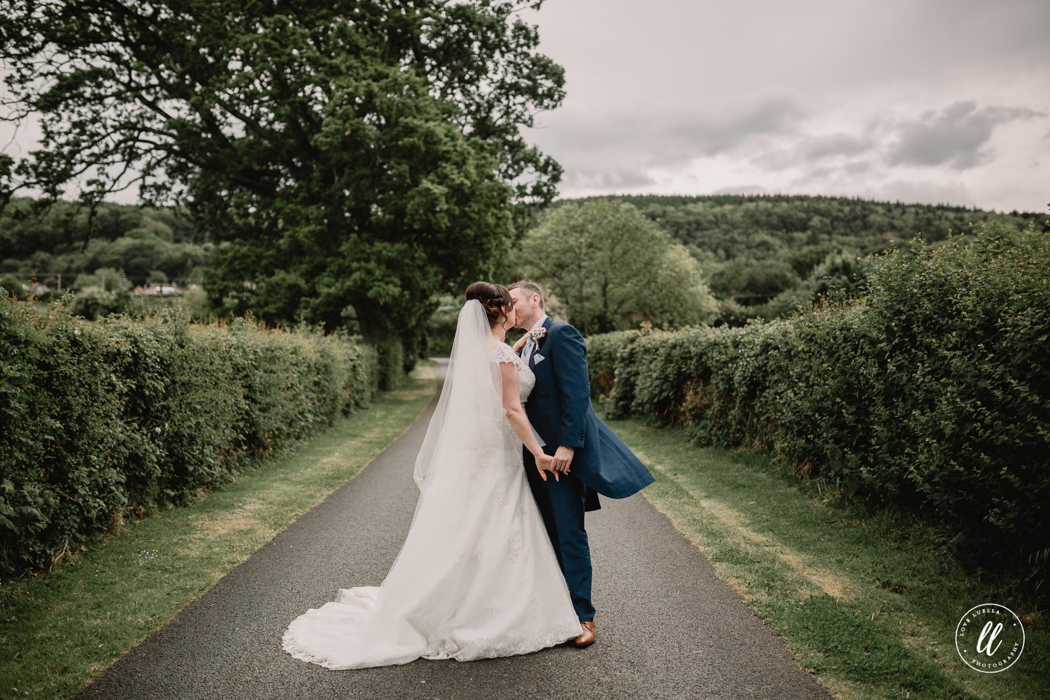 The happy couple kissing outside The Kinmel Wedding Venue