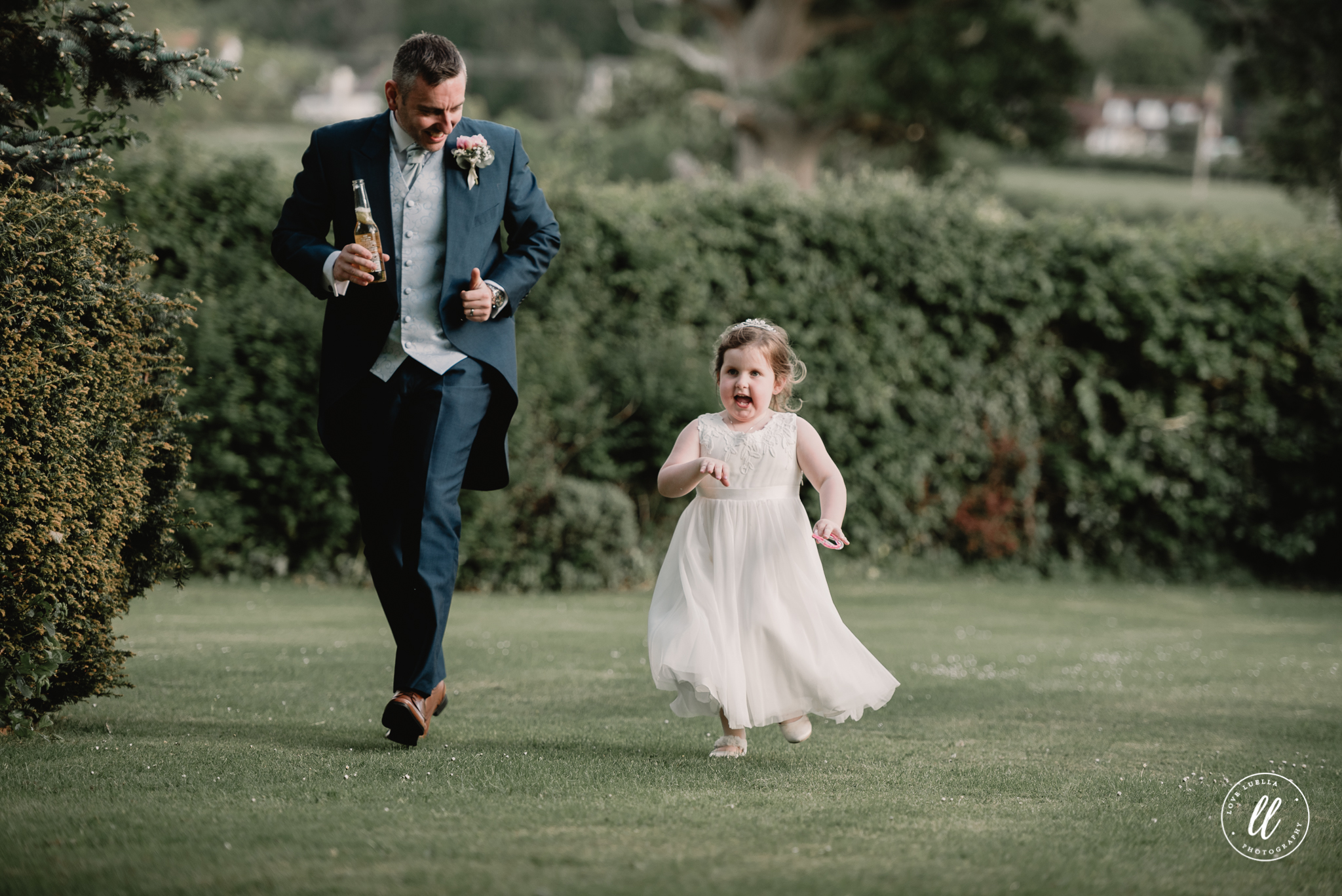 Father and daughter playfully running on the wedding day