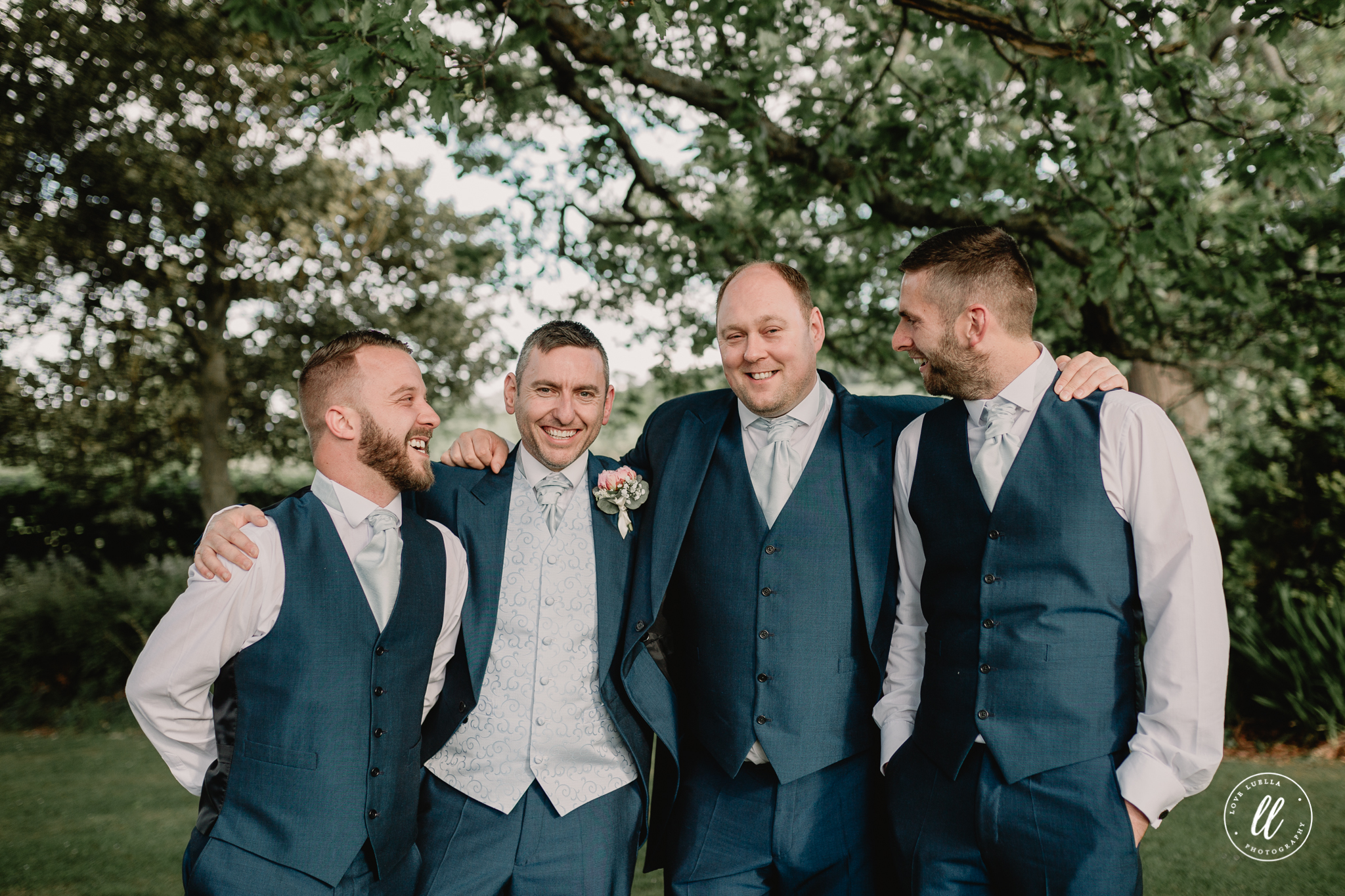 the groom and his groomsmen in the gardens of kinmel manor