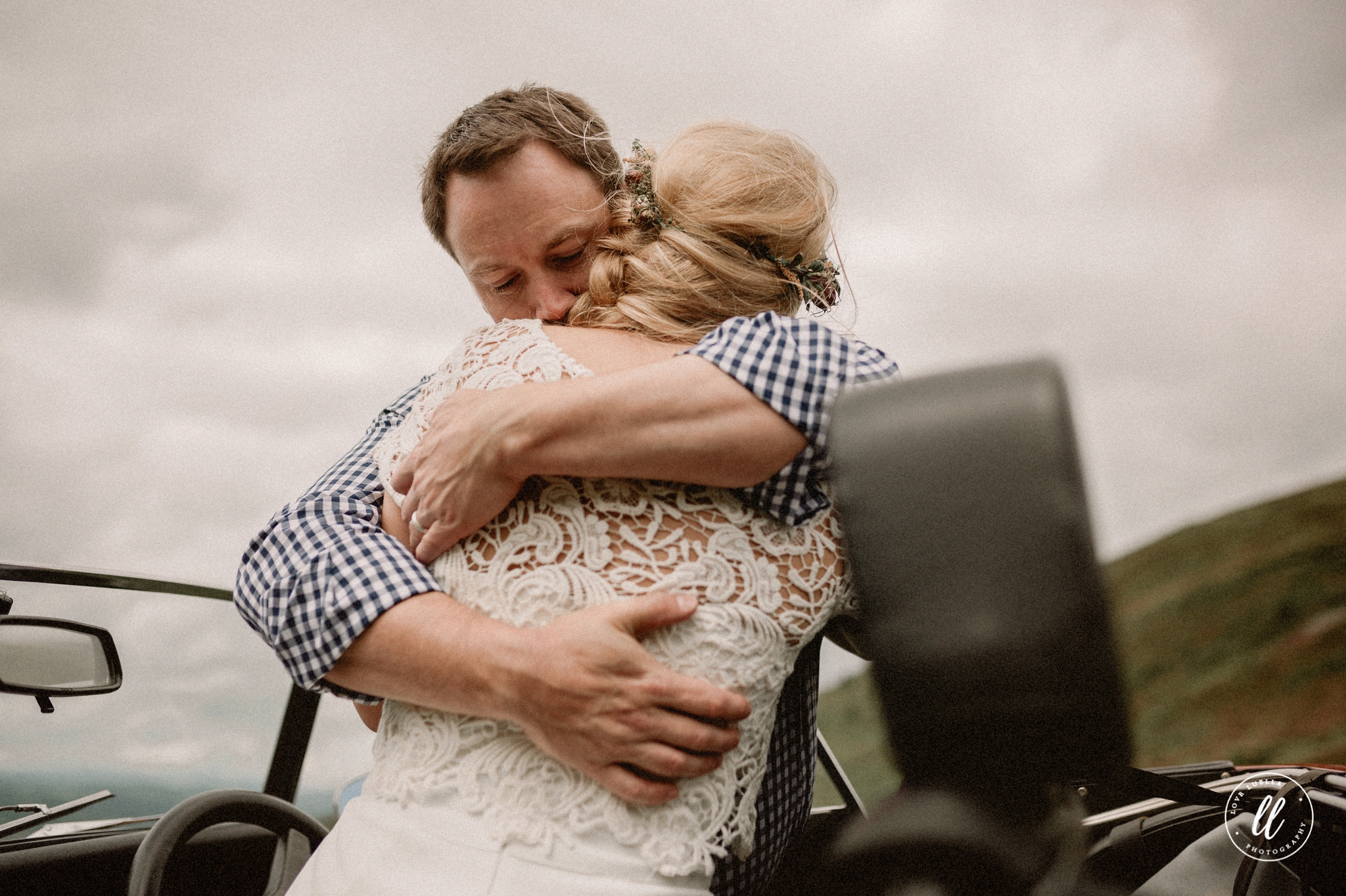 Couple Embracing On Top Of A Mountain In Ruthin North Wales