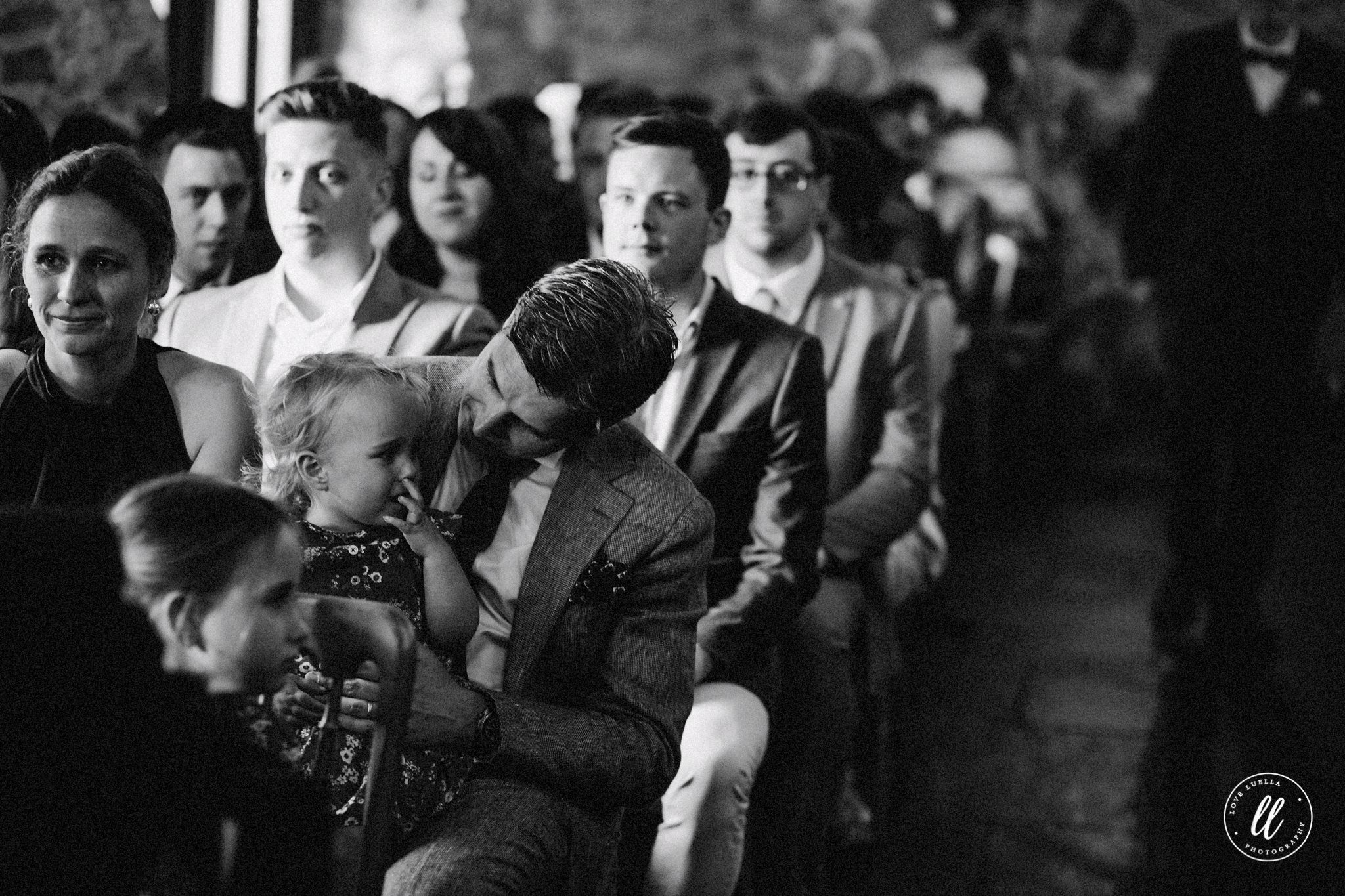 father consoling his child mid ceremony