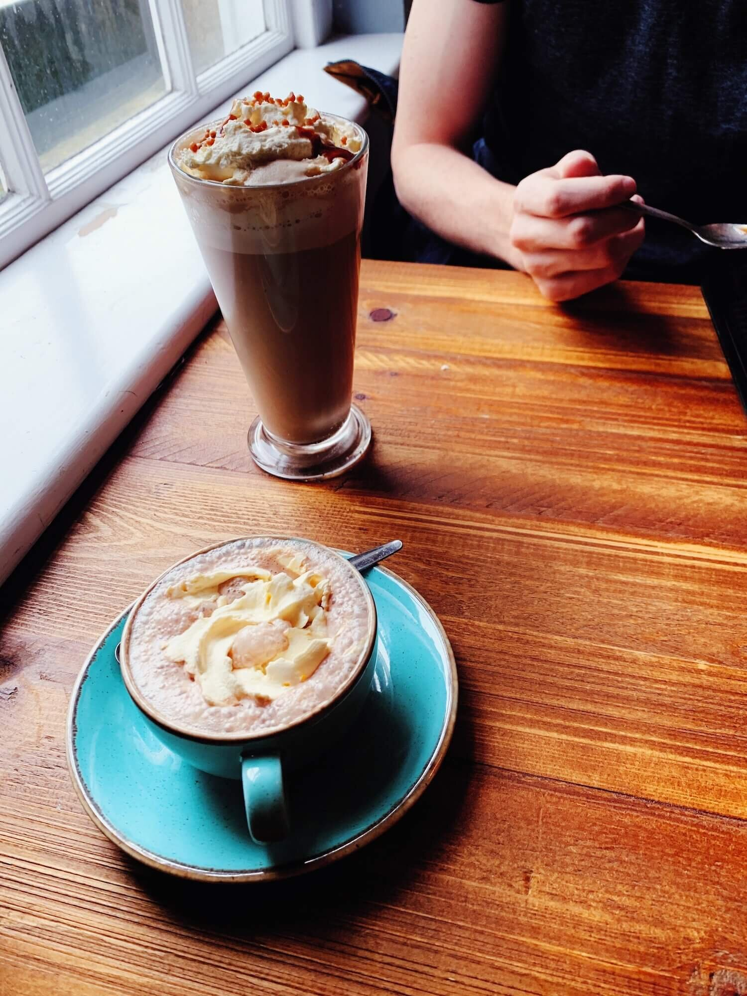 This was our second coffeeshop of the day — I forced us to duck inside when the rain got a little too cold and heavy. He had some latte/caramel/sugar contraption and I had a hot coco with vegan whipped cream. It was delightful.