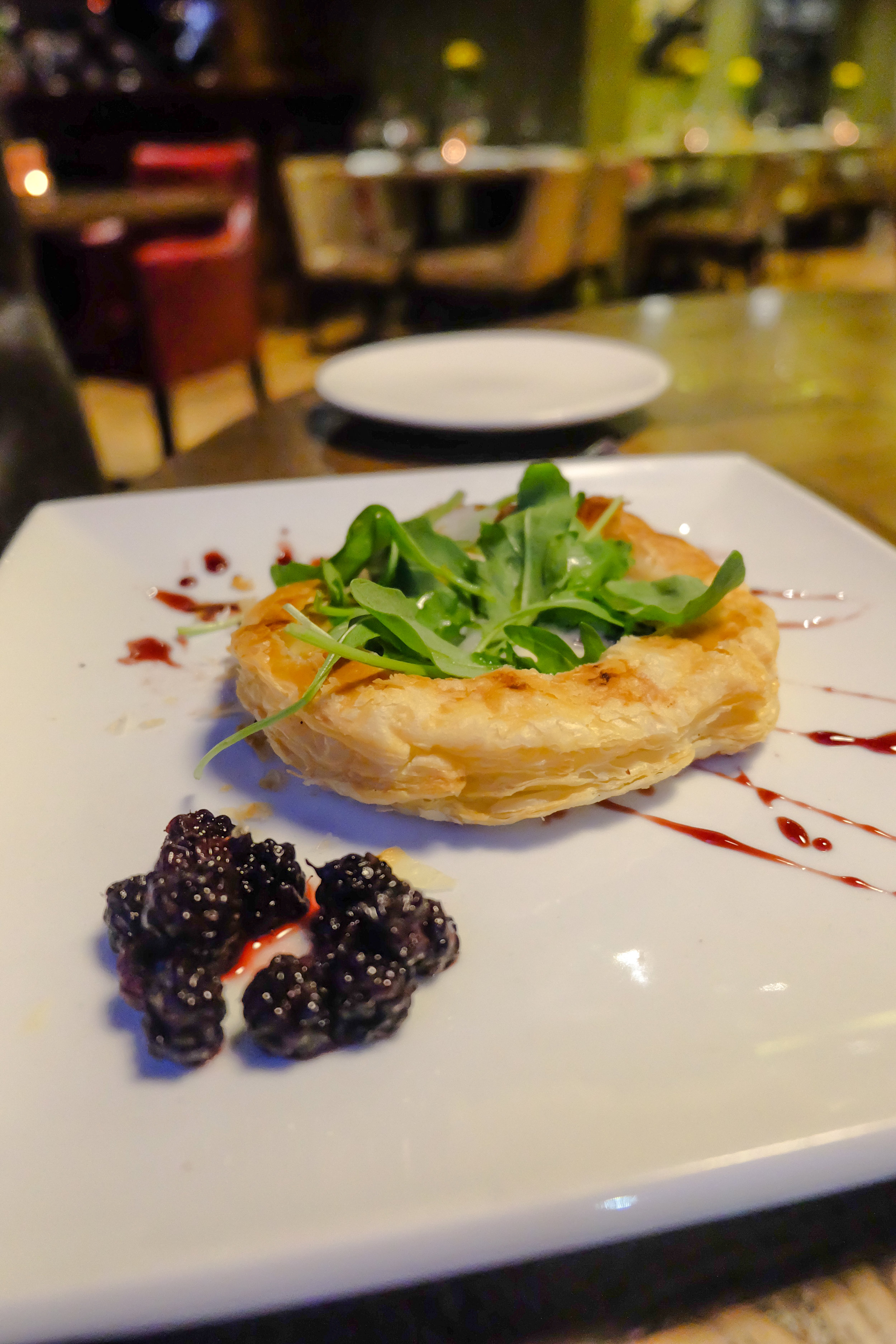 Cheese tart with blackberries