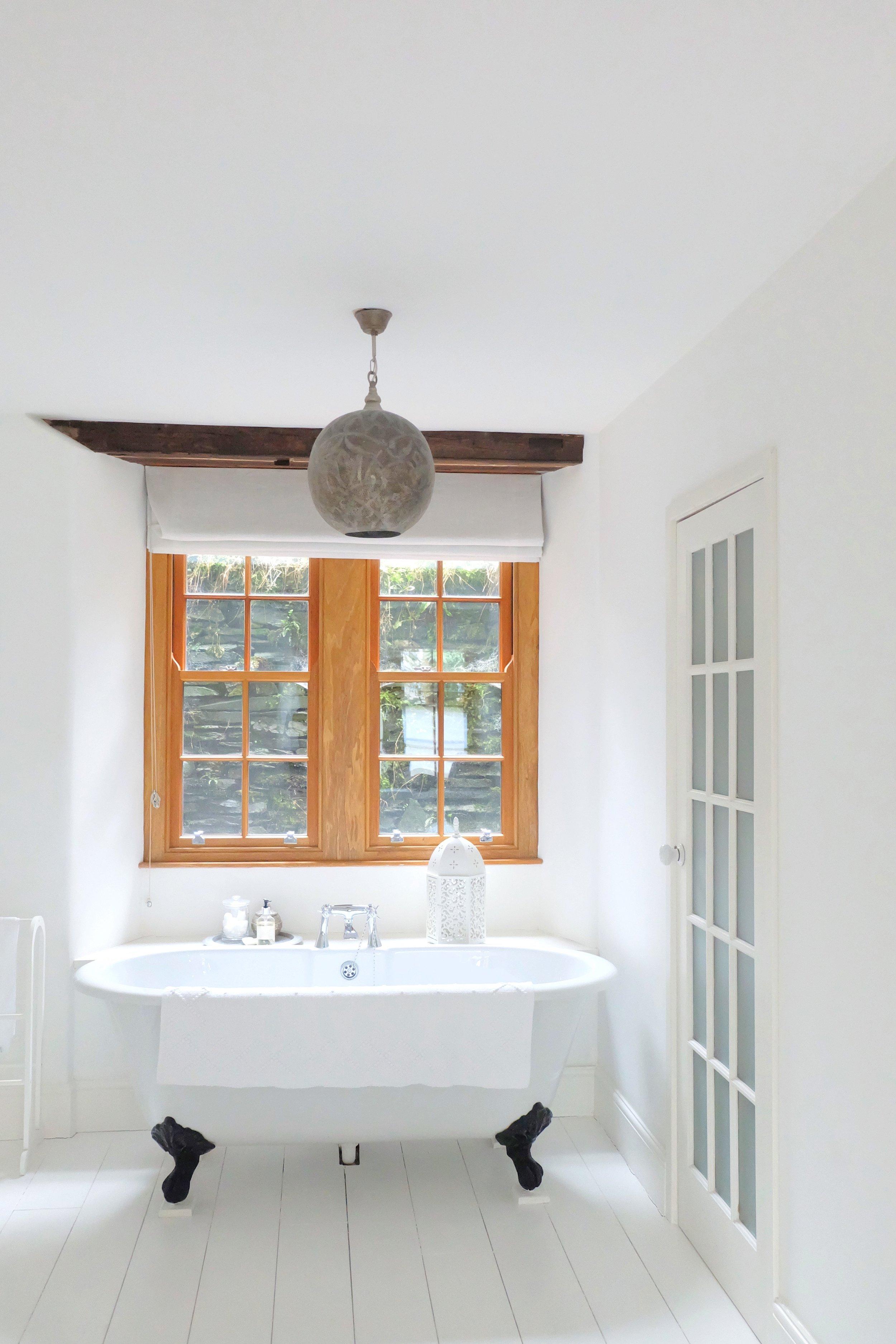 Bedroom with freestanding bath