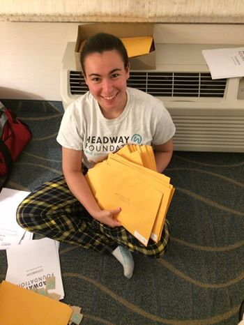 (Above) Renberg writing letters of encouragement and packaging items.