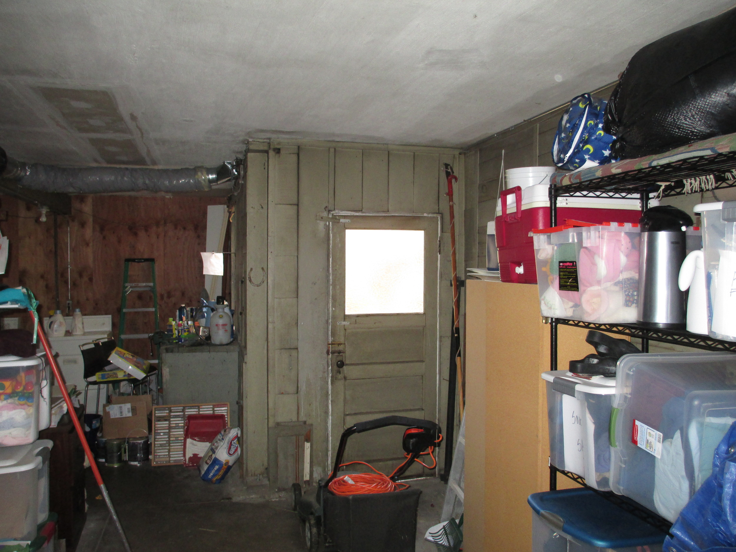 "Garage level formerly used for storage.... see ""after"" photo below."