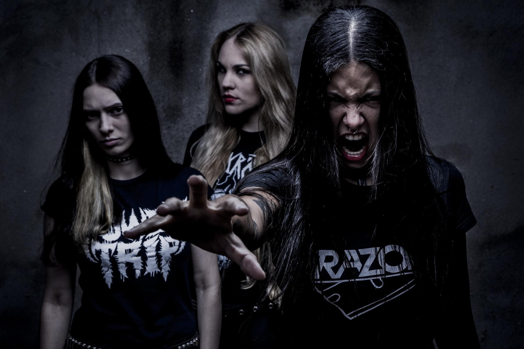 """On June 1st NERVOSA will deliver their blistering slab of metal on Napalm Records. Get ready for the   """"Downfall of Mankind""""  .  This Brazilian all-female thrash commando unit is synonymous with raw aggression and untamed power. They deliver a massive punch to the face and a kick in the gut on their albums, and when they take to the stage they are a force to be reckoned with. For their third album   """"Downfall of Mankind""""  ,the trio joined forces with producer Martin Furia who has worked with artists including the likes of Destruction, Flotsam & Jetsam and Evil Invaders.  Fernanda Lira comments on the new album:  """"We're really happy about this new album. It's a way more mature and aggressive record and we can definitely say it's our favorite so far!""""   NERVOSA are currently on the road with Venom Inc. and Suffocation throughout Europe. A complete list of dates can be found below.  The full track listing of   """"Downfall of Mankind""""  reads as follows: 1. Intro 2. Horrordome 3. Never Forget, Never Repeat 4. Enslave 5. Bleeding 6. ... And Justice for Whom? 7. Vultures 8. Kill the Silence 9. No Mercy 10. Raise Your Fist! 11. Fear, Violence and Massacre 12. Conflict 13. Cultura do Estupro 14. Selfish Battle (Bonus Track)  It comes as no surprise genre legends such as João Gordo (Ratos de Porão), Rodrigo Oliveira (Korzus) and Michael Gilbert (Flotsam & Jetsam) were thrilled to be studio guests!"""
