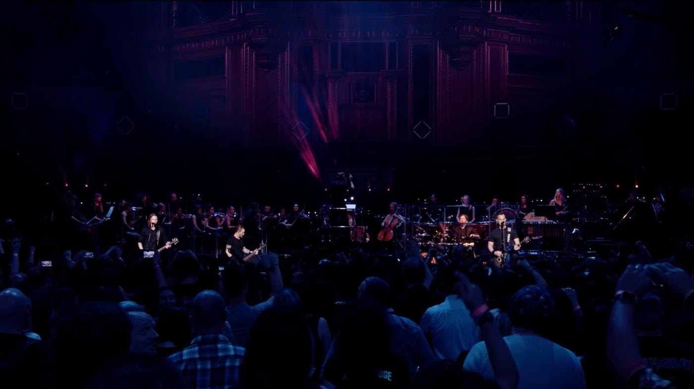 """Performance Taken From The Complete Concert Event Scheduled For Release Worldwide On September 7 Via Napalm Records    Now Available for Pre-Order In Various Audio And Video Configurations at http://smarturl.it/LiveFromTRAH & www.alterbridge.com    Coming on the heels of the announcement of  Alter Bridge's  career-defining live release Live At The Royal Albert Hall Featuring the Parallax Orchestra, the band is releasing another video from the live performance. The latest track being released, """"Words Darker Than Their Wings,"""" is a song from the band's 2010 ABIII album that, until those two shows in October 2017, had never been previously performed live. The longtime crowd favorite showcases the first time that Myles Kennedy and Mark Tremonti share lead vocal duties, something that would be repeated on """"Waters Rising"""" from the Fortress release. The video for the track can be seen here: https://youtu.be/fTvJ1TYORJg and the audio is available via all streaming partners.  """"'Words Darker Than Their Wings' was a song that we never played before ever and its been one of our favorites, especially me and Scott Phillips. That's been one of our top 3 Alter Bridge songs since we wrote it and its just one of those songs that we have been trying and trying and trying to play live and Myles is always kind of pushing back about it and finally, you know with this orchestra he [Myles] said this is the perfect time to do it. We did and it was the biggest reaction of both nights,"""" explains Mark Tremonti in the full-length movie of the concert.  After 14 years performing together, five full-length studio albums, and countless sold-out shows around the globe, Alter Bridge  is releasing the epic  Live At The Royal Albert Hall on September 7th via Napalm Records. The live album and DVD was recorded in October 2017 when the band performed two sold-out shows at London's iconic Royal Albert Hall backed by the 52-piece Parallax Orchestra led by conductor Simon Dobson. Live At The Royal Albert H"""