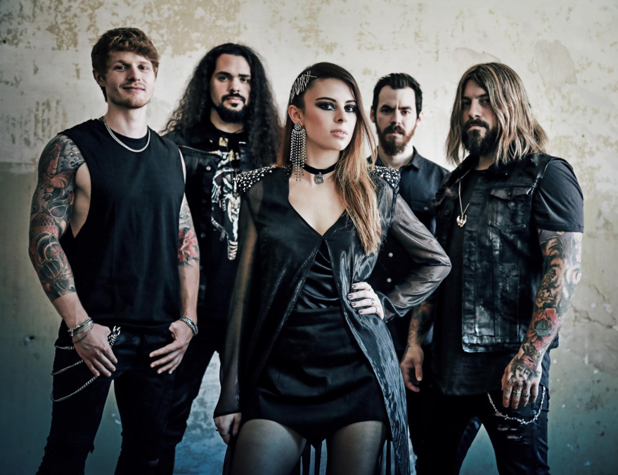"""Photo Credit: Heilemania            Just one month remains until  BEYOND THE BLACK  will release their brand-new album   Heart Of The Hurricane   out on August 31 via Napalm Records (GSA via Airforce1).    BEYOND THE BLACK   celebrate a true story of success!Their debut album   Songs Of Love And Death   (2015) immediately scored #12 on the German album charts. Only one year later their latest release,  Lost In Forever   (2016) stormed the charts again and a top 5 ranking catapulted the band even further forward! We can't wait for their promising new release   Heart Of The Hurricane  !  Today the band reveals their official music video for the song """" Million Lightyears """". With this heartfelt and powerful song about being stranded away from oneself and each other, the vocal duo of  BEYOND THE BLACK  shine in the new video for  """"Million Lightyears """"!  Dive into """"   Million Lightyears   """"   HERE!     BEYOND THE BLACK  is pure symphonic metal full of energy, straightforward and without any compromises! Their engines are hot, and roaring straight into the   Heart Of The Hurricane  . The title of the third album is not just a catchy phrase, it's a promise. It's the result of two years of hard work skyrocketing the band to the next level."""