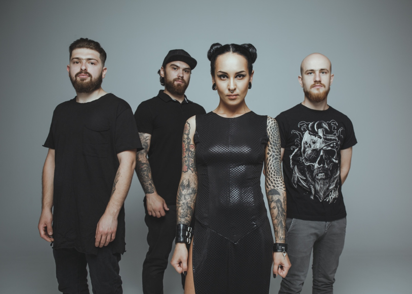"""Through their unique and heavy sound and over the top live performances, the Ukraine-based band JINJER have quickly become one the most talked about names in the heavy metal landscape today. Hailed by Loudwire as """"Technical, Groovy and Anthemic,"""" JINJER have cemented this status even more with the release of their new single entitled """" Ape .""""The single is available for purchase and streaming HERE .  Watch the video for """" Ape """" HERE .  Bassist Euge Kostyuk comments on the new song """" Ape """"  """"It's been two years since we have released new material, and it was high time to bring something brand new to the table. By last Spring we collected a bunch of musical ideas which we eagerly wanted to turn into songs, in other words we really had something to say with our music. So here you are! This Fall is the season of JINJER .""""   JINJER will provide direct support to DevilDriver on their upcoming U.S. tour which kicks off this coming Tuesday October 23rdin Phoenix, AZ. The tour runs through November 18thin San Diego, CA.A complete list of dates can be found below.  Says the band of the upcoming tour:  """"We are super stoked to start the Fall American tour with DevilDriver and Raven Black playing brand new songs.""""  Watch a commercial for the tour HERE .  Since the release of 2016's """" King of Everything """", JINJER's groundbreaking second album """" Cloud Factory """" was re-issued in February 2018, both via Napalm Records .  Get a taste of JINJER live from the videos below:    """"Pisces"""" (Live)      """"Bad Water"""" (Live)      """"Cloud Factory"""" (Live)     Jinjer with DevilDriver and Raven Black    10/23: Phoenix, AZ @ Marquee    10/25: Dallas, TX @ Gas Monkey    10/26: Houston, TX @ Scout Bar    10/27: Austin, TX @ Texas Revolution Fest*    10/28: Oklahoma City, OK @ Diamond Ballroom    10/30: Louisville, KY @ Manchester Music Hall    10/31: Cleveland, OH @ Agora Ballroom    11/1: Rochester, NY @ Montage Music Hall    11/2: Brooklyn, NY @ Brooklyn Bazaar    11/4: Providence, RI @ Providence Meta"""