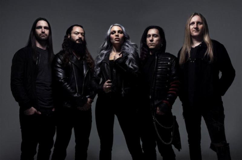 """'Evolution' out September 20th on Napalm Records    WATCH: Music Video for New Single """"Burn!""""   Calgary-based hard rock quintet  KOBRA AND THE LOTUS  have returned with their new studio album ' Evolution ', which will get a  September 20th  release on  Napalm Records. The upcoming LP sees the band imbued with a new fire that comes through by way of undeniable hooks, soaring guitar riffs, marching drum beats, and the soulful, bombastic vocal delivery of lead singer  Kobra Paige . No longer bound by old formulas and expectations from the past, ' Evolution ' comes through with a sound that is expansive and, at times, borders on outright swagger. Each song feels like an Active Rock hit in the making, while still having the grit and feverish intensity that longtime fans have come to admire from  Kobra and the Lotus .  Fans can now enjoy the first offering from ' Evolution '. The band has dropped their music video for the new single """" Burn !"""", which can be   HERE  .  ' Evolution ' boasts the band's most cohesive and confident material to date. For the new record, Kobra and the Lotus enlisted the services of producer  Michael """"Elvis"""" Baskette [Alter Bridge, Linkin Park, Slash, Sevendust].  """"The new body of work sets the tone for the music going forward. Sonically, it's still heavy. It highlights the showmanship and maintains the edge. At the same time, it's approachable. It pays tribute to our influences, but it takes the next step. So, it's a reintroduction to us and a rebirth. A firm goal was to build a strong identity and update everything. We just want to be  Kobra and the Lotus ; that's what we're doing.  The first single, """" Burn !"""" ignites this chapter. A hummable riff snaps into a visceral verse as the frontwoman directly declares, """"I really hate you, yes I do."""" The track builds towards an incendiary and infectious chorus, hinging on a seesawing guttural groove and hitting like a sledgehammer.  """"It's about all of the reasons you hold yourself back,"""" she explains. """"Y"""