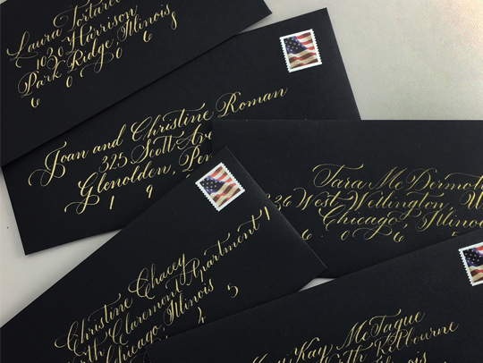 Copperplate style calligraphy in gold ink