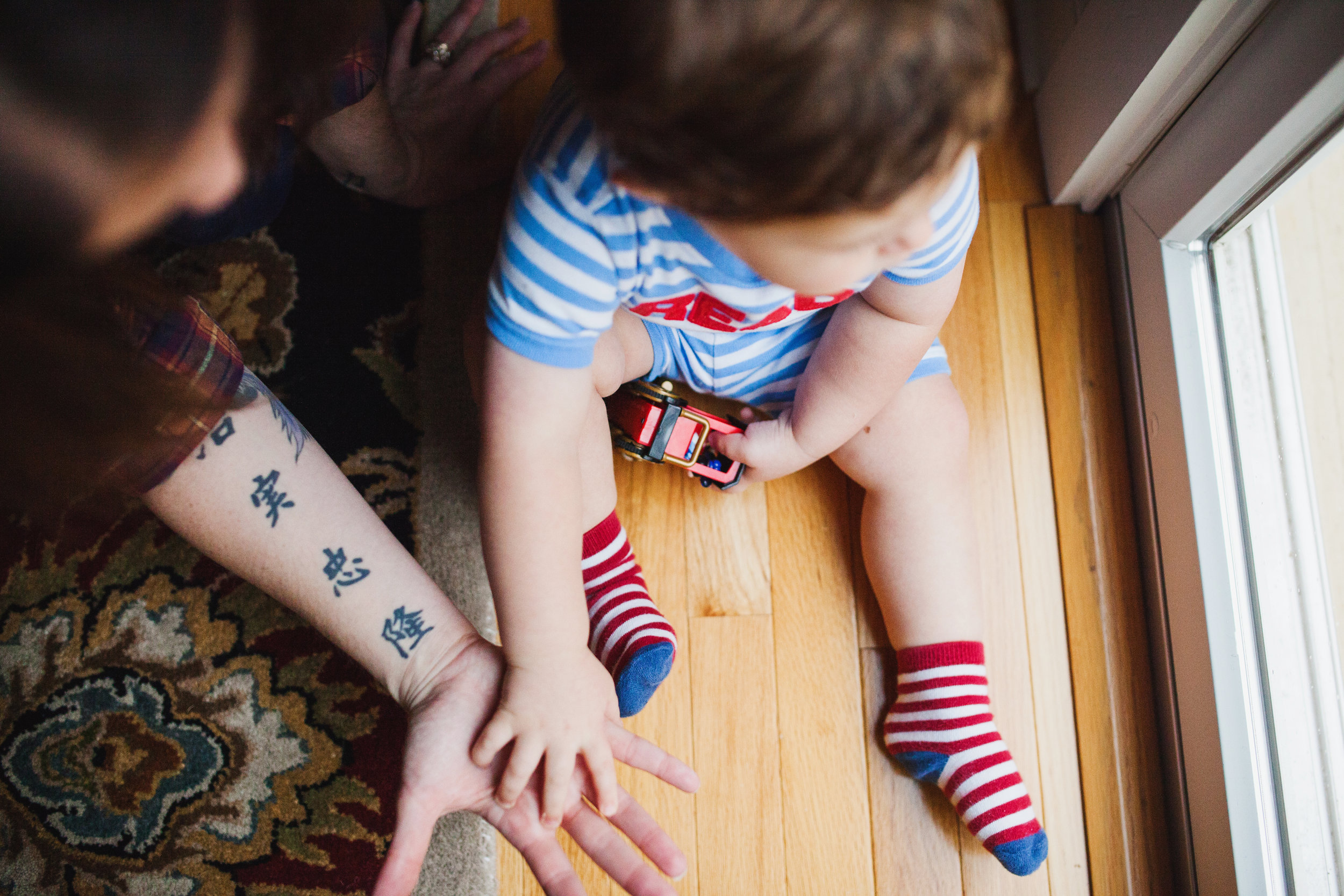 Toddler in striped socks Audrey Blake Photography.jpg
