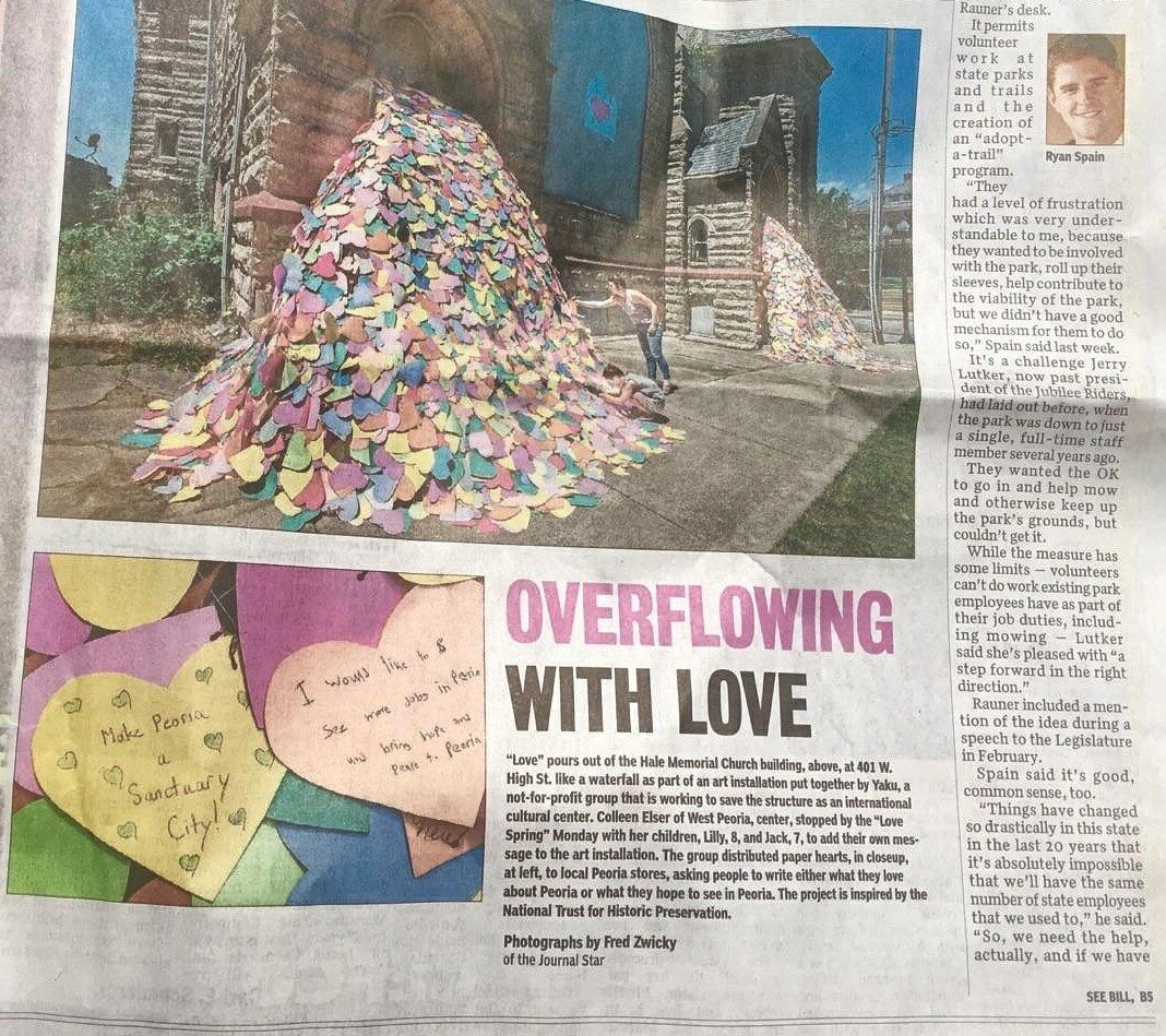 """OVERFLOWING WITH LOVE - """"Love"""" pours out of the Hale Memorial Church building, above, at 401 w High st. like a waterfall as part of an installation put together by Yaku, a not for profit group that is working to save the structure as an international cultural center. HERE"""