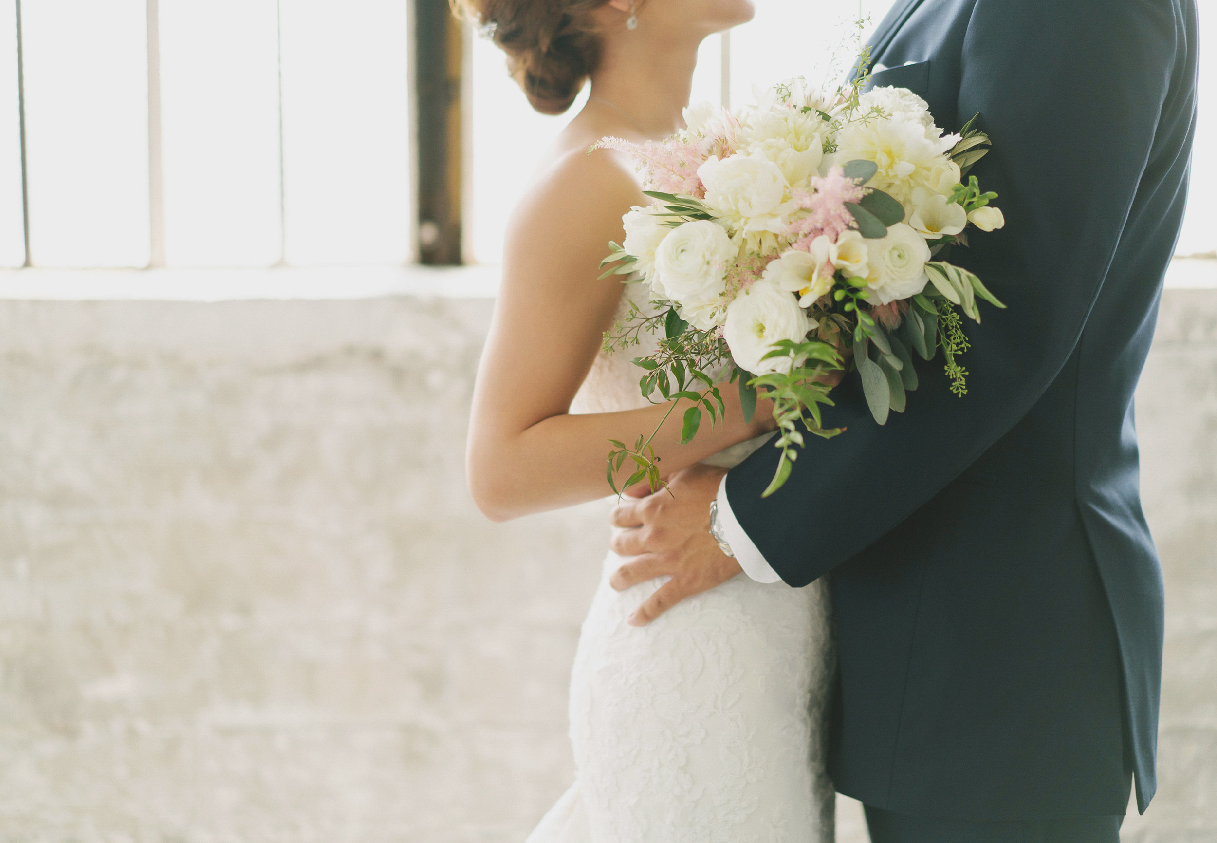 The bride's bouquet was soft with white Dahlias, Rancuculus, Blush Astilbes, and fragrant Fresias . Over flowing with Jasmine vines.