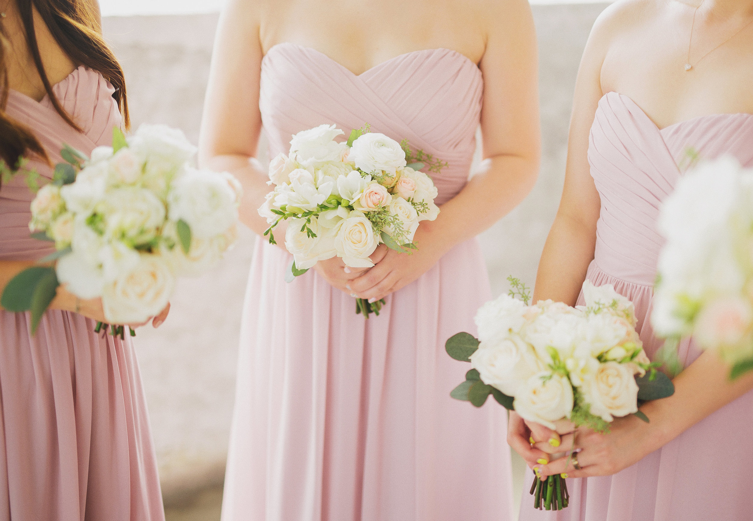 The bridesmaids carried ivory and blush flowers with hints of green to compliment the bride and their blush dresses.