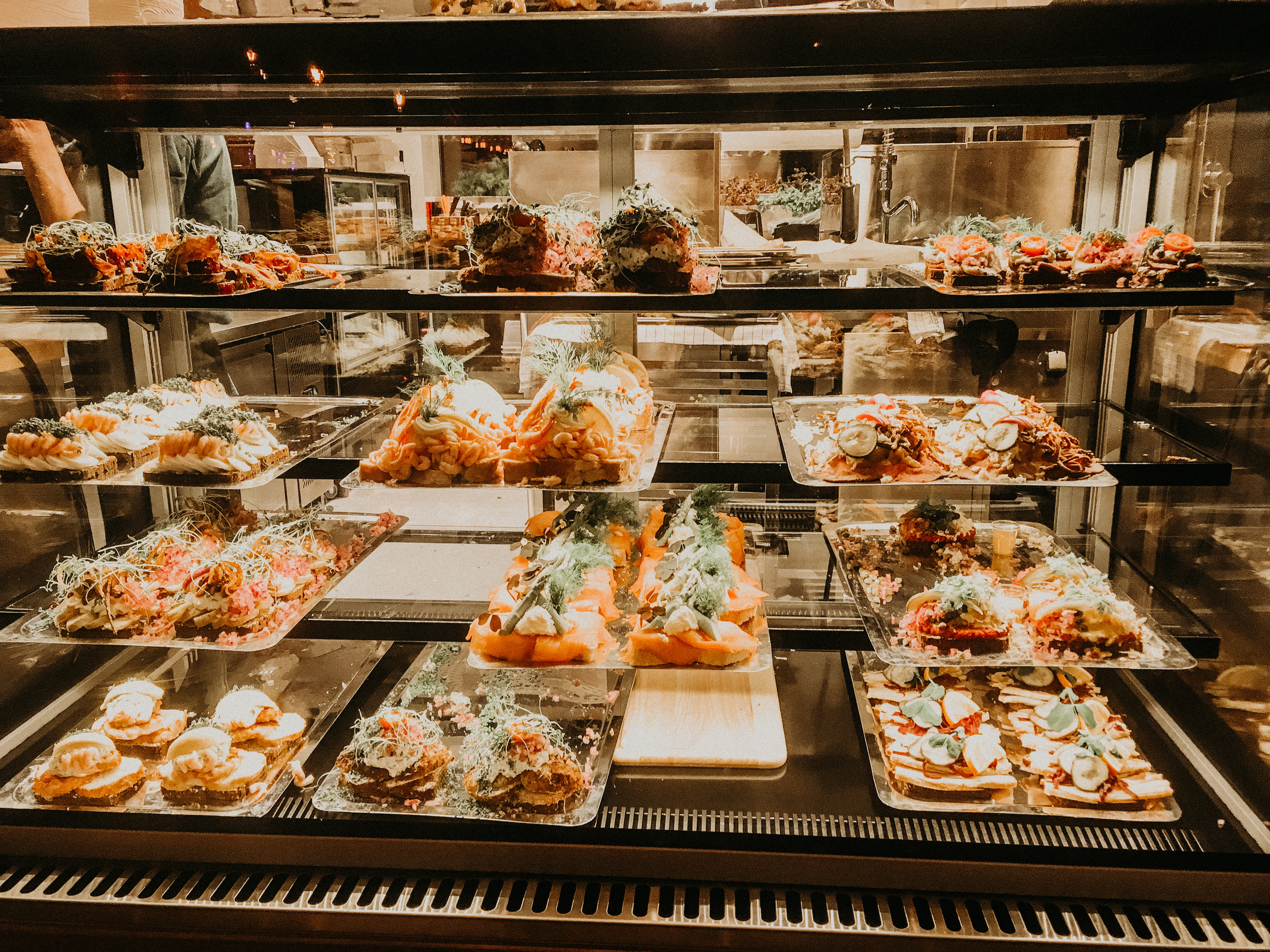 Smørrebrød (Danish open-faced sandwiches) -There are so many places to try them, however we had them for dinner at the  Tivoli Food Hall .