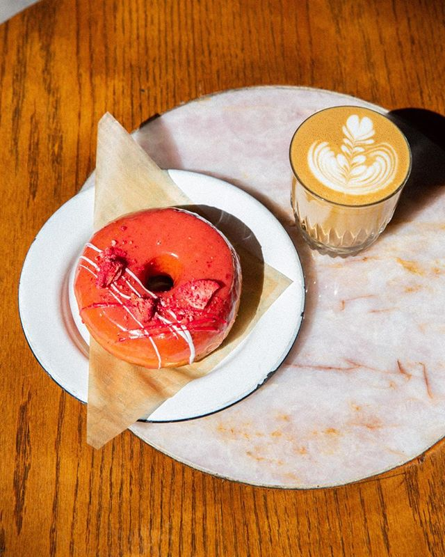 Today 👏🏼 is 👏🏼 the 👏🏼 day!! We have always felt incredibly grateful to have this @thesaltydonut collaboration, where we work together on creating a fun flavor that's exclusively available at our coffee bar. Today is the first day of our summer flavor: their classic 24-hour brioche ring, filled with a lychee ganache and topped with a fresh strawberry glaze, and white chocolate drizzle. Seriously the best donut yet in our opinion 🍓☀️🍩👏🏼😋