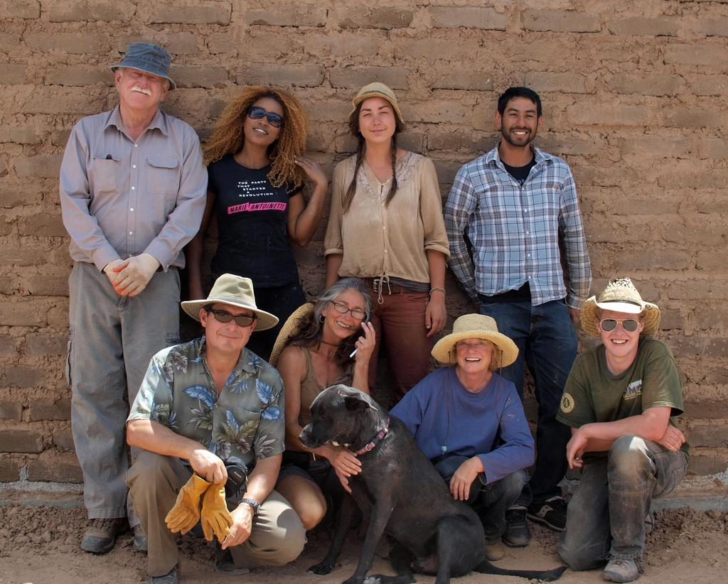 Adobe in Action owner builder support team in front of a completed adobe wall in Abiquiu, NM.