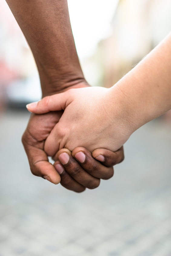 interracial holding hands