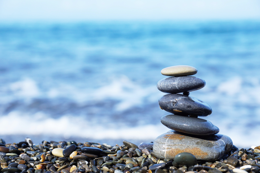zen rocks stacked by the ocean