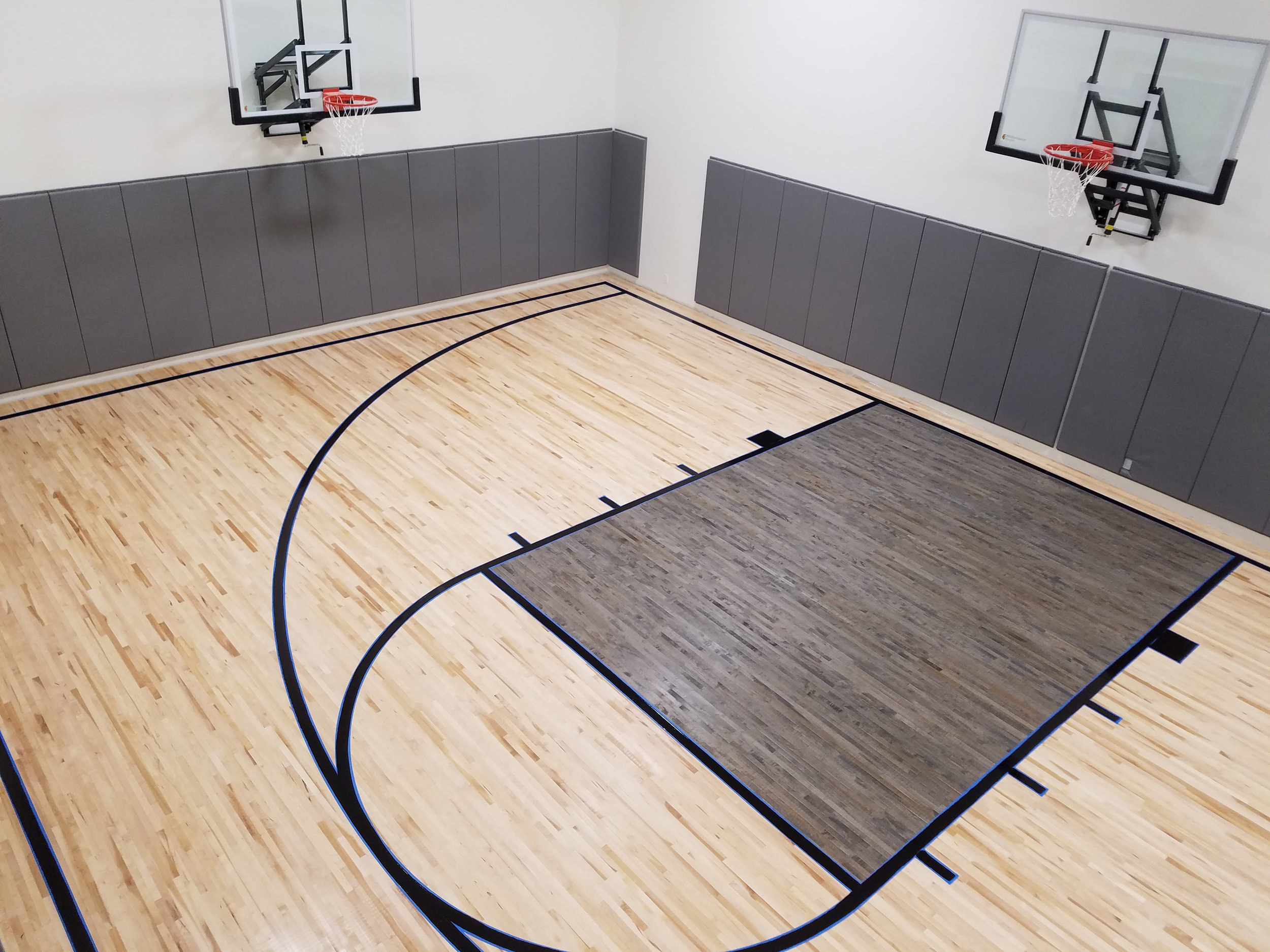 Residential gym Installations - 2nd or better Maple flooring with charcoal gray stain