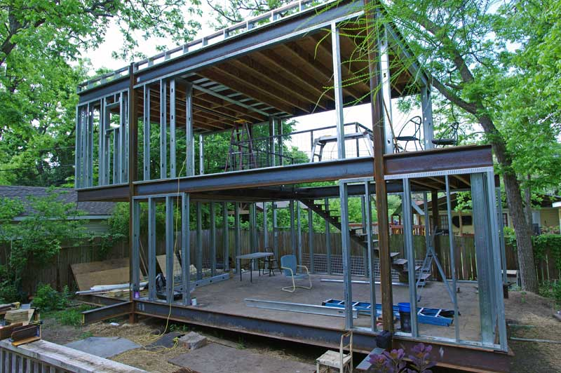 Infill framing. Large 12' x 8' entry to the lower studio will bring in lots of light and tie the 'dirty' studio with the wrap-around deck.