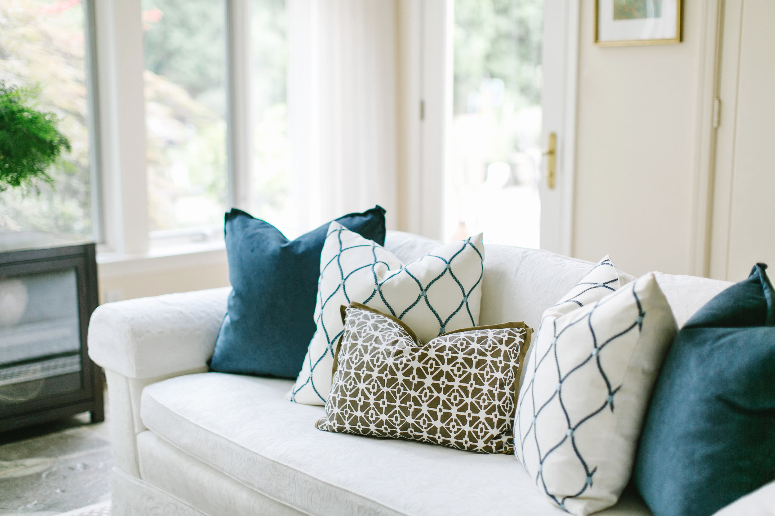 Unique upholstered accent pillows on a sofa