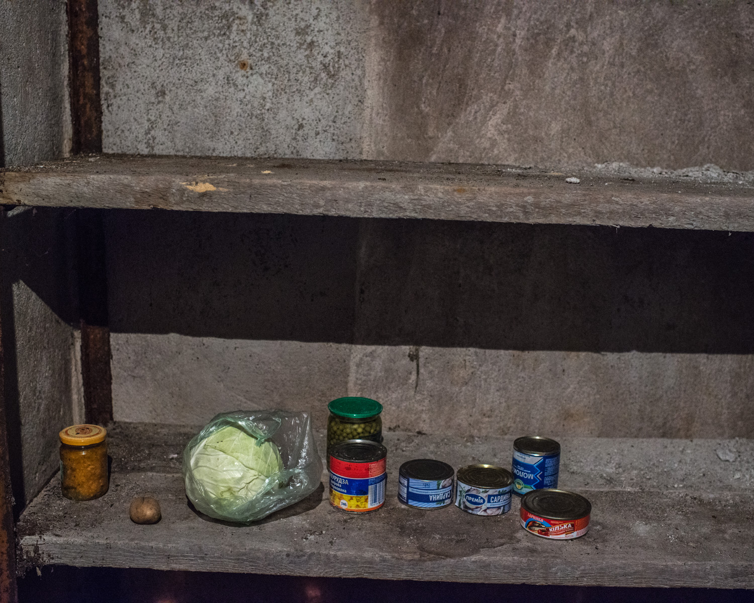 A bare cupboard in the village of Gnutove. Food prices have skyrocketed and deliveries to stores near the front line have grown less frequent. Increasingly, people must rely on food they've stored or are able to grow themselves.