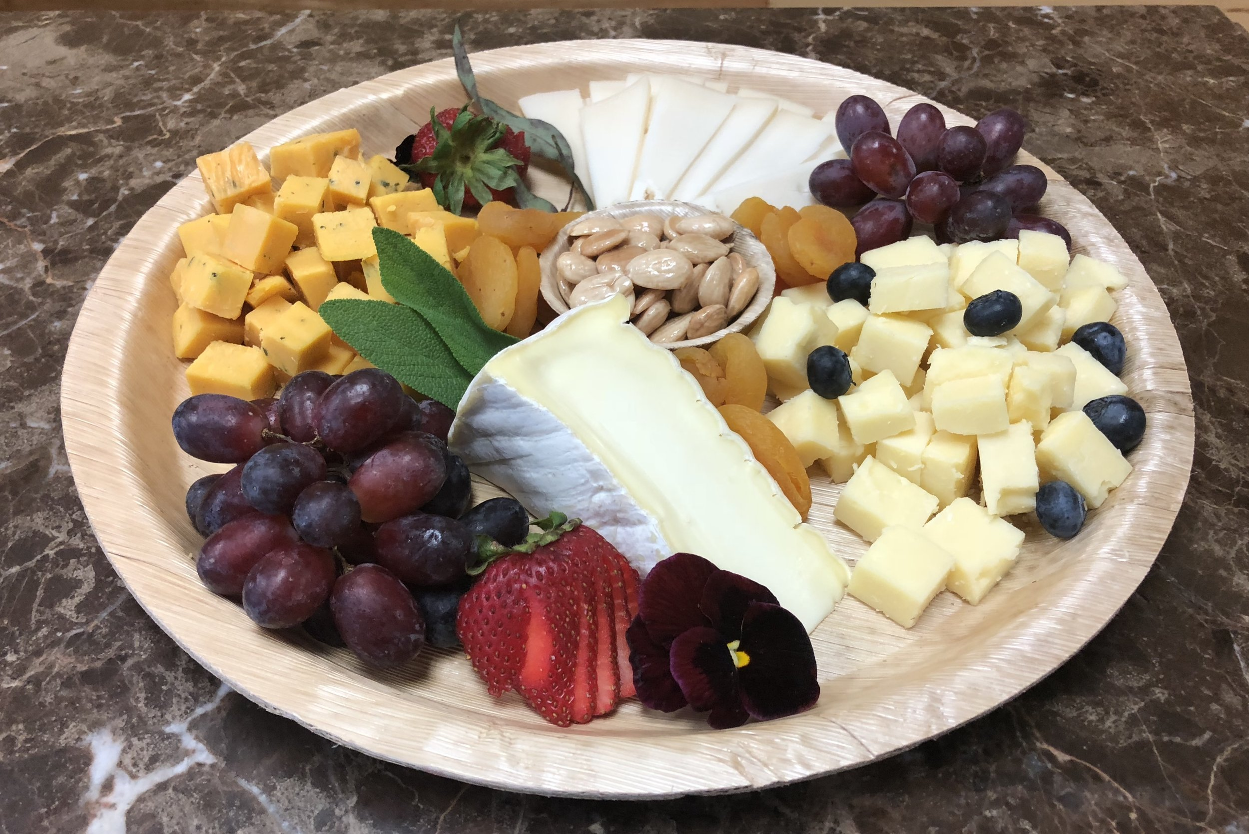 Medium Cheese Plate - Four select cheese, nuts, fruit, mixed greens