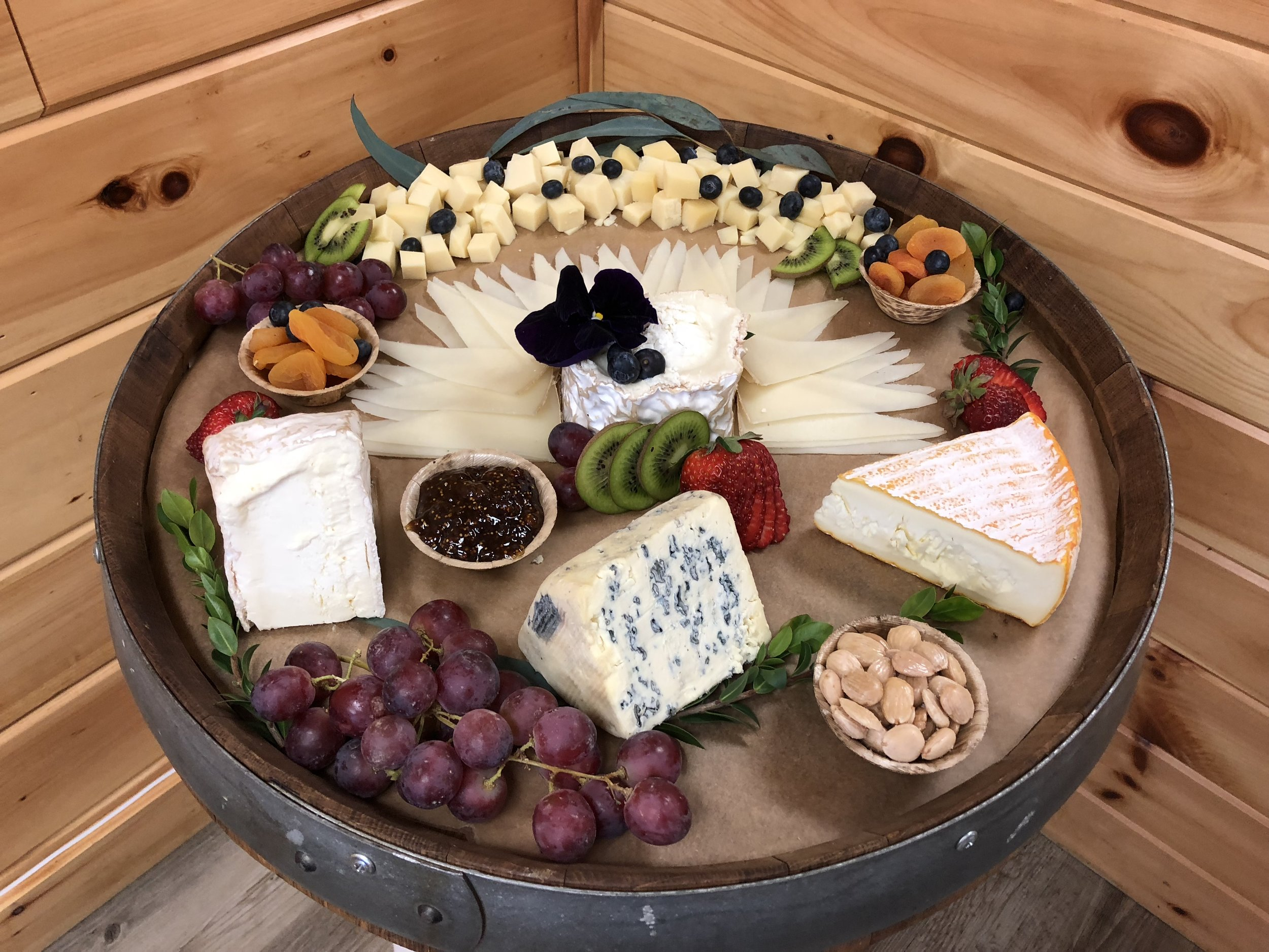 Custom Cheese Boards - Assorted cheese & charcuterie, nuts, dried fruit, fruit, fig preserve & mixed greens(size dependent on guest count)