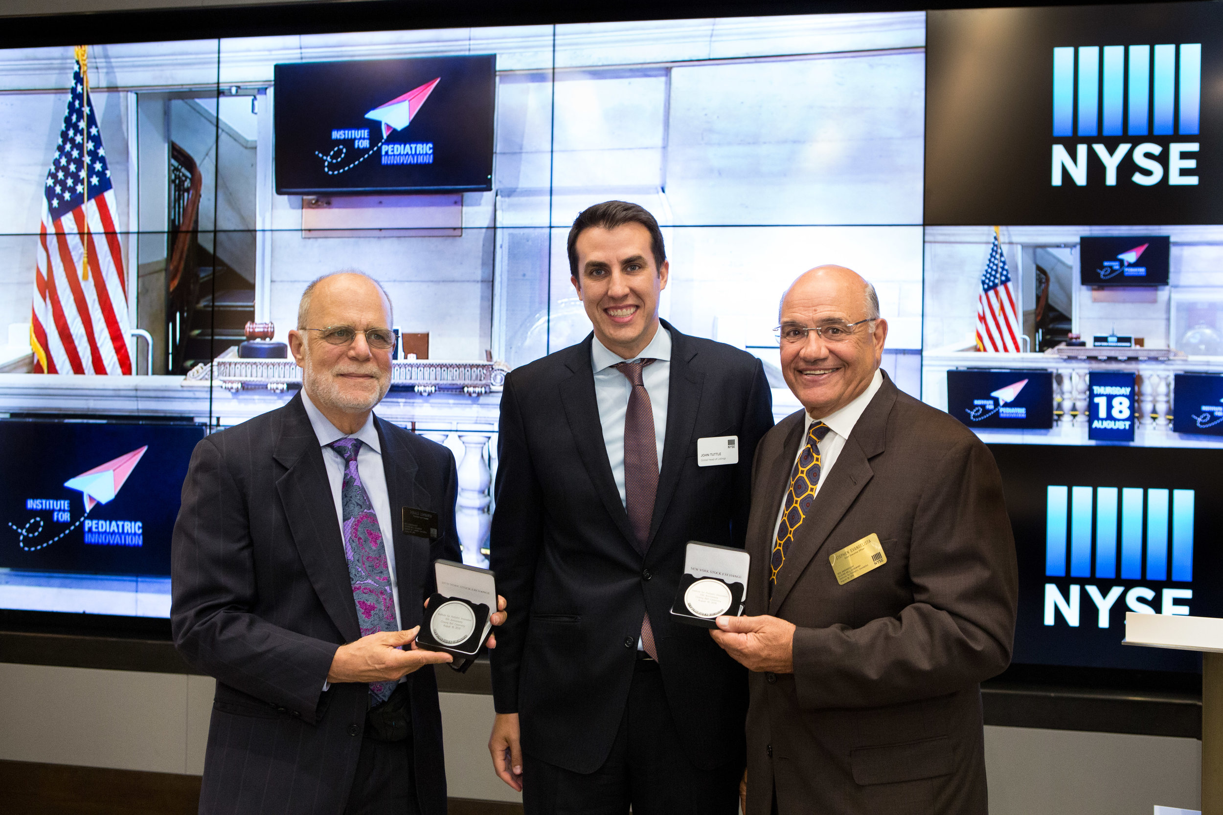 President and Founder Don Lombardi (left) and CEO Stephan Evangelista (right) show off their thank you medallions. Photo Credit: NYSE