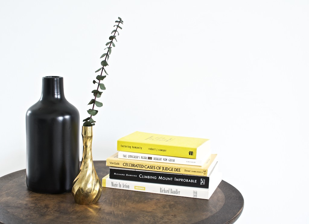 tall vase was painted black to highlight the brass. black vase under $5.