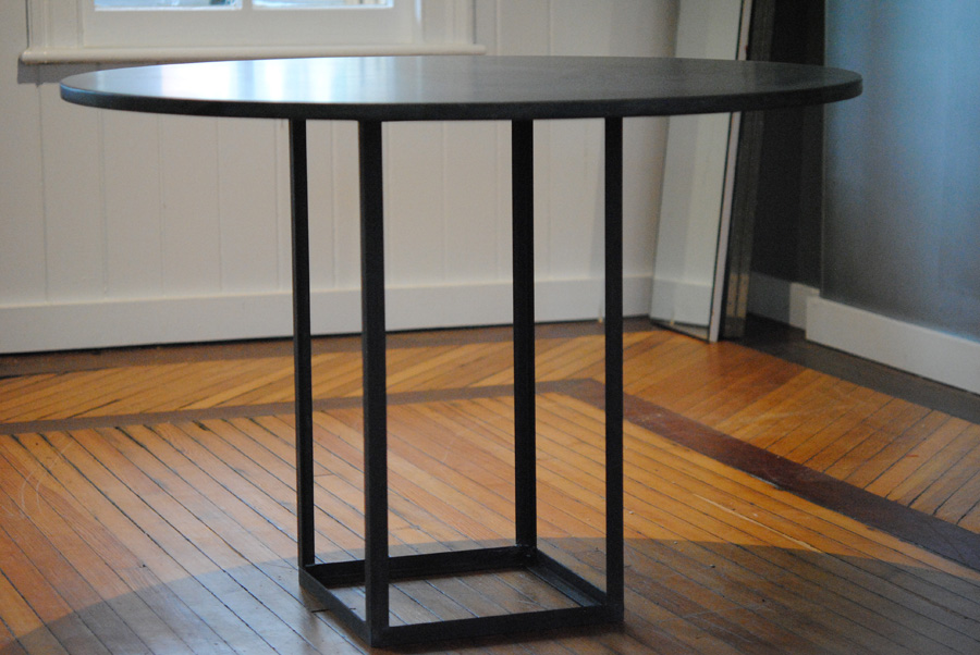 Open square base with granite top dining table