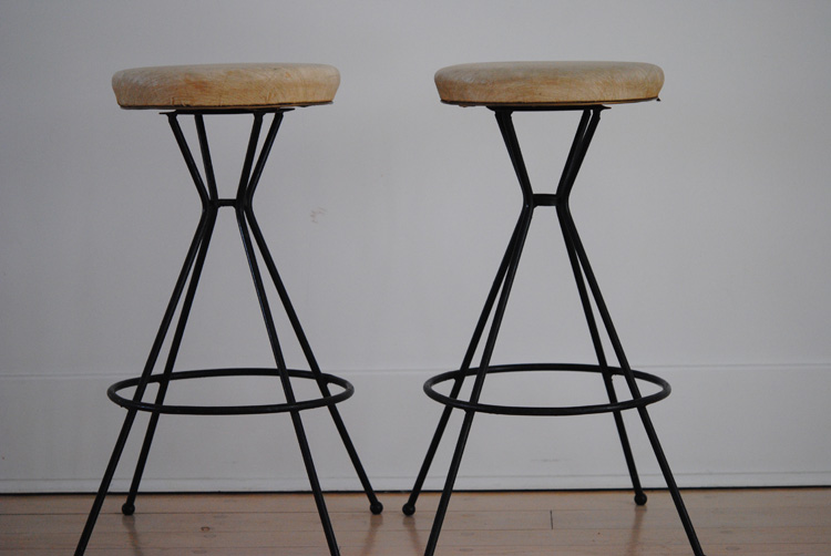 Mid century black iron and cream vinyl stools