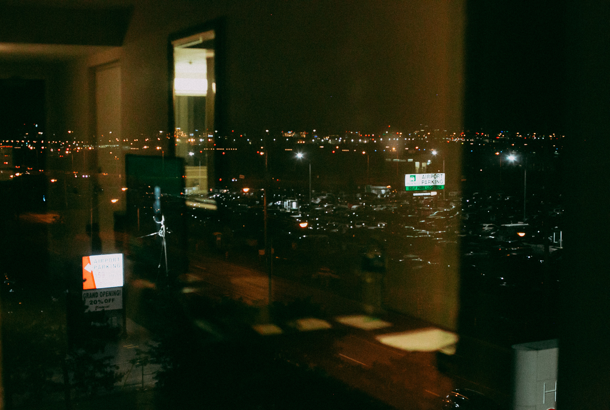 Somewhere in the Toronto airport district - Reflections looking out a hotel room window the night before our flight. Tomorrow morning it's straight to the Island of Aruba.
