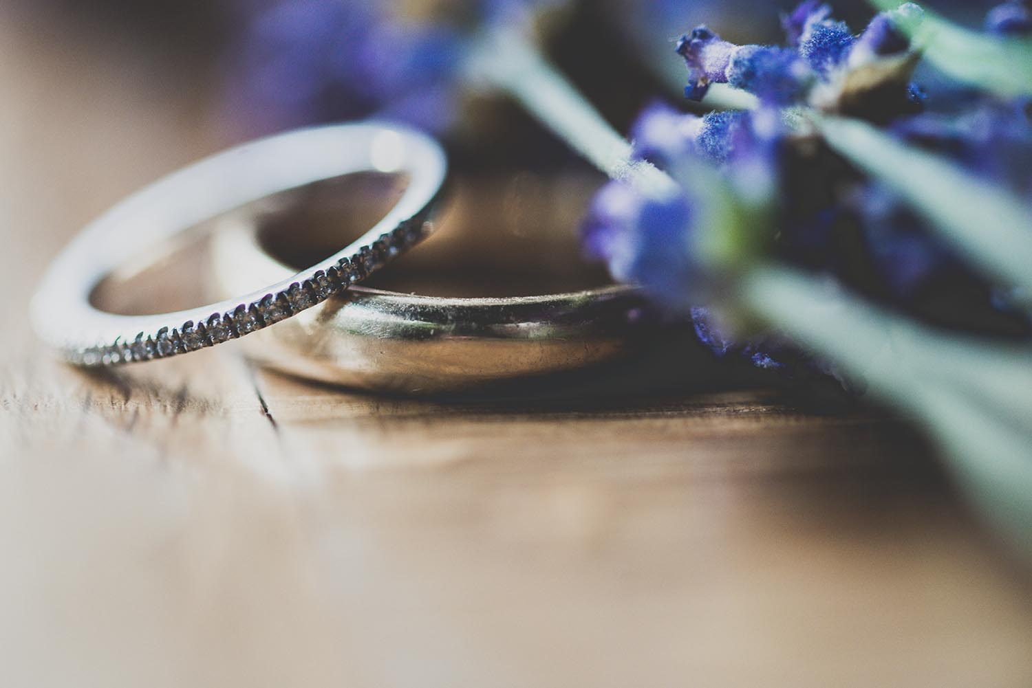 photography of wedding rings and flowers shot with a relaxed documentary style in North Wales