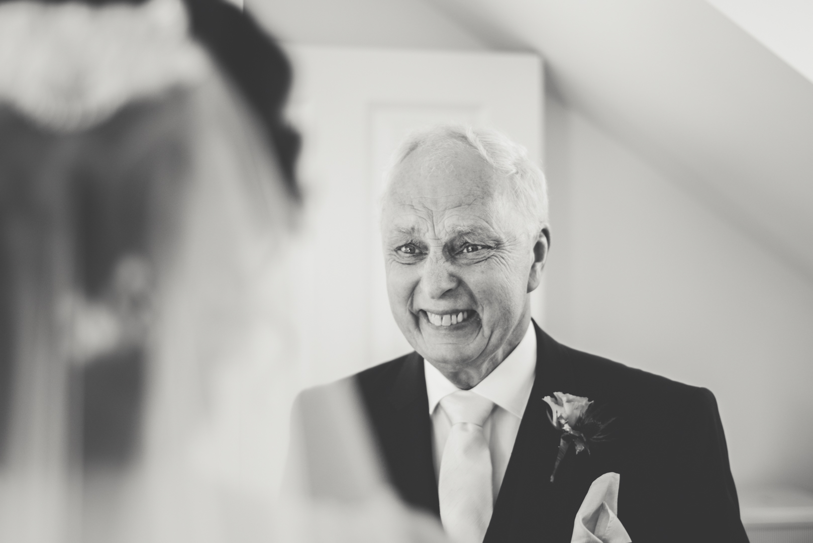 Father of the bride emotion at a seaside venue in North Wales