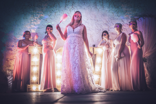 Wedding candy floss in hand and lighting to match.