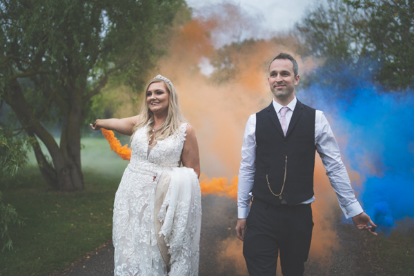 Documentary wedding photographer north wales smoke bombs