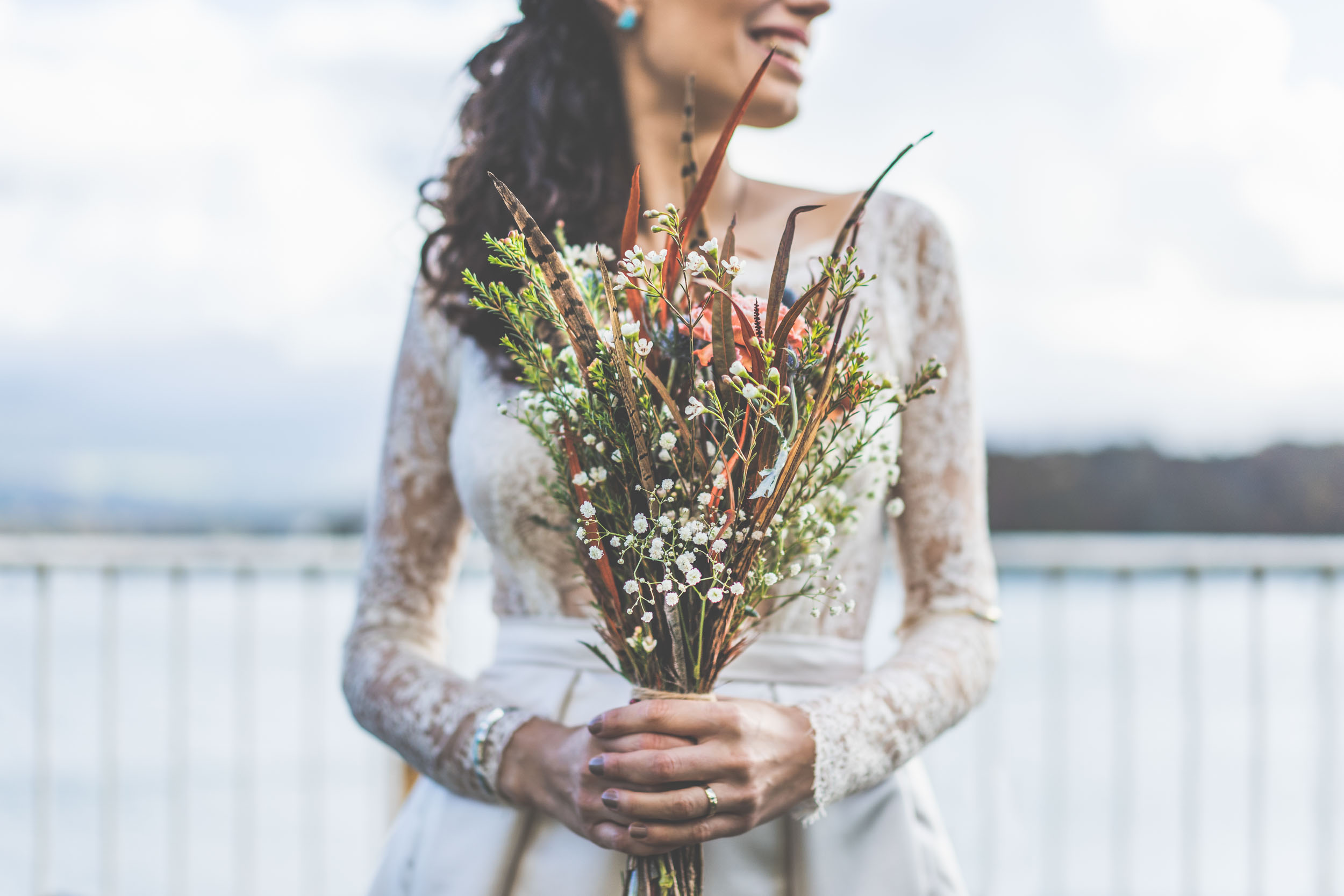 natural wedding bouquet and dress. Menai Straits North Wales.
