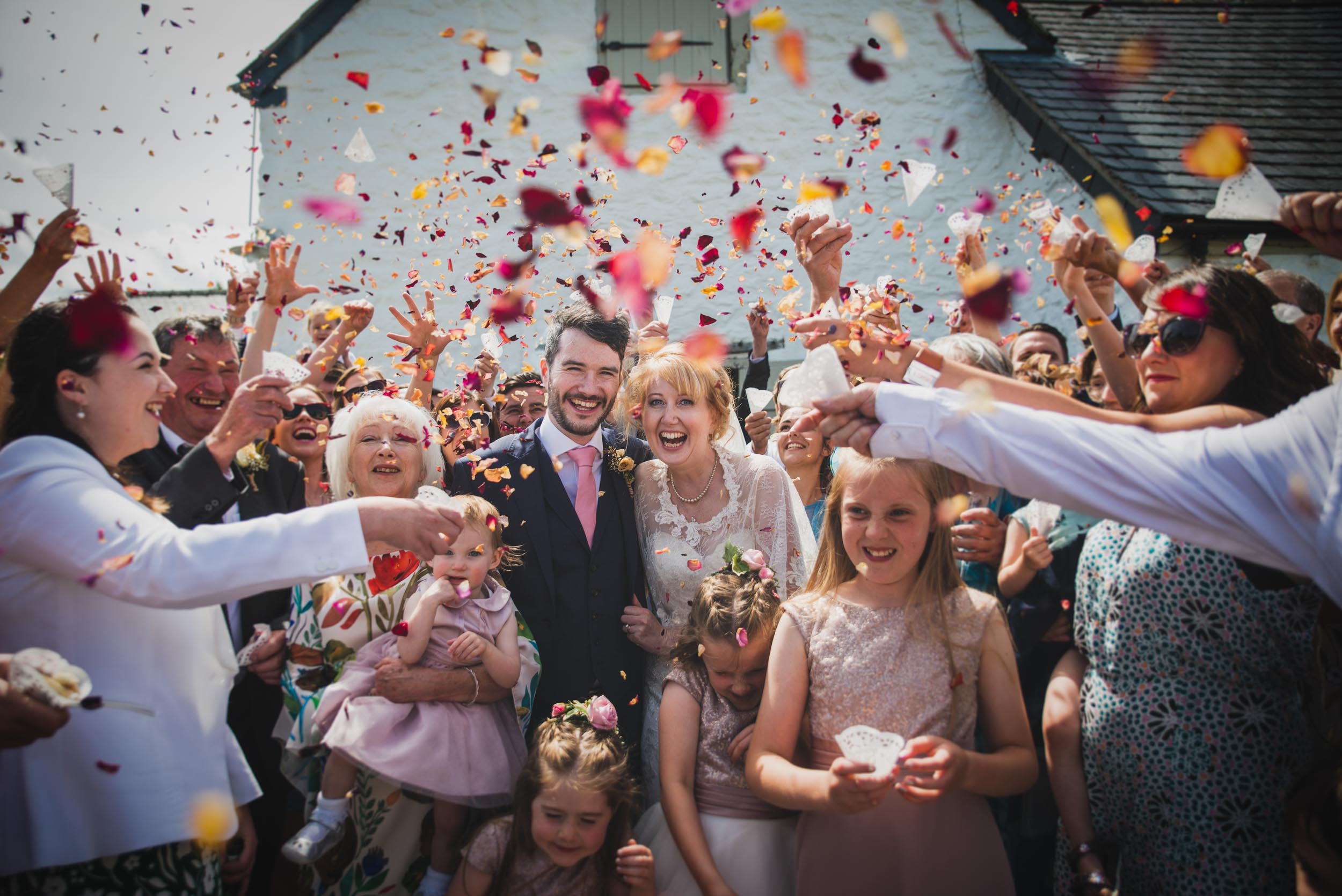 Traditional confetti throw at a farm wedding in North Wales