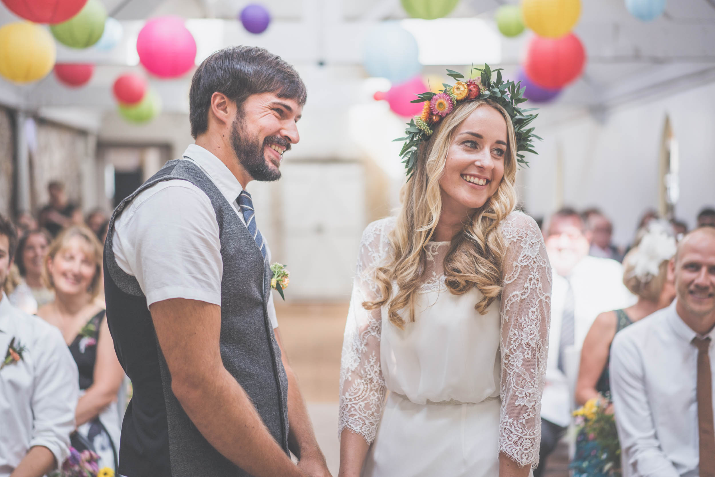 Happy newly wed couple aisle smile, North Wales.
