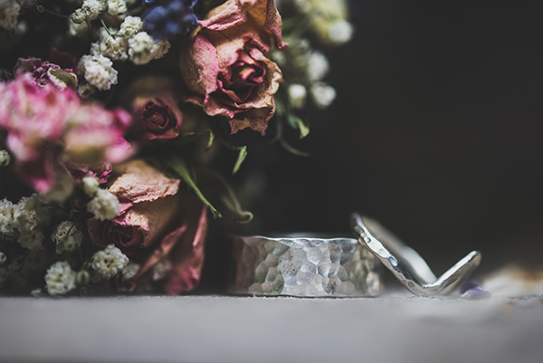 Photography at a rustic North Wales, Anglesey farm wedding with wonderful rings and flower detail
