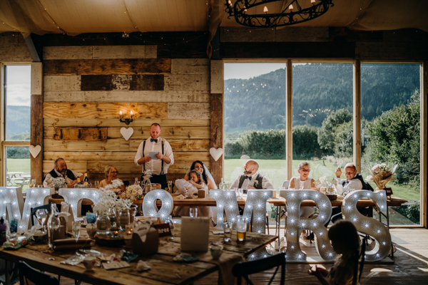 Wedding day speeches - Documentary wedding photography at the sunny bright North Wales venue Hafod Farm
