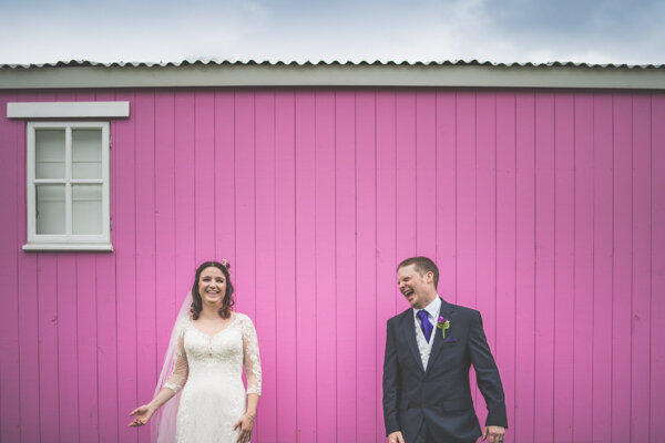 Bright and colourful wedding photography, the Pink hut at the outbuldings, Anglesey, North Wales.