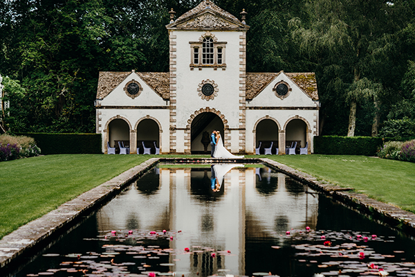 A wedding at the classical Pin Mill on the Canal Terrace, Bodnant Garden, Conwy, North Wales.