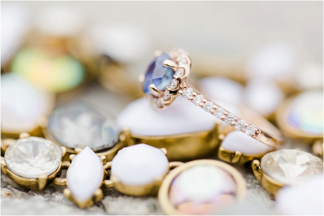 A rose gold and sapphire engagement ring photographed by Deborah Zoe Photography.