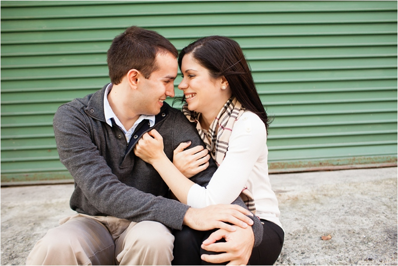 couple cuddling on sidewalk in boston