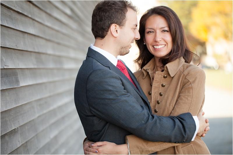 couple cuddling during engagement session in Salem, Massachusetts